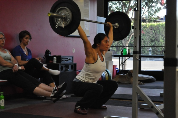 Lori and Lisa behind me seem to really trust that I'm not going to drop that barbell on them.
