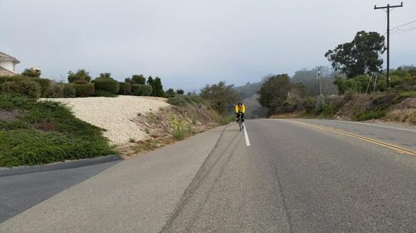 Cortney climbs up a misty hill.