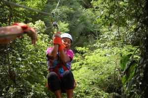 Apparently Pua is a little scared of ziplining in Belizean jungles.
