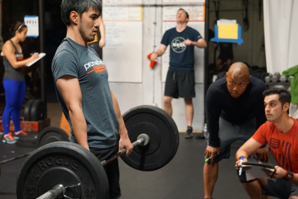We take our deadlifts seriously at Prometheus CrossFit. The fact that this picture was taken during the Open 15.2 has nothing to do with the intent coaching gaze. Well... maybe it has a little something to do with it.