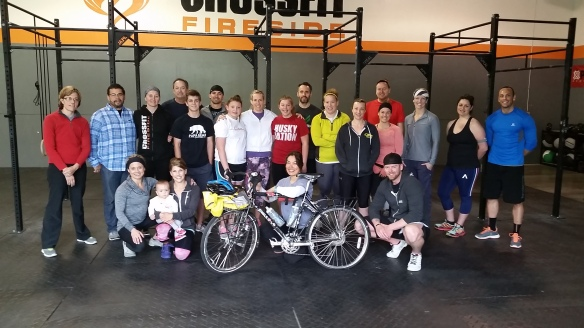 Group photo at CrossFit Fireside! Catie insisted that Lutz be in the picture, despite not looking his best with his flat tire.